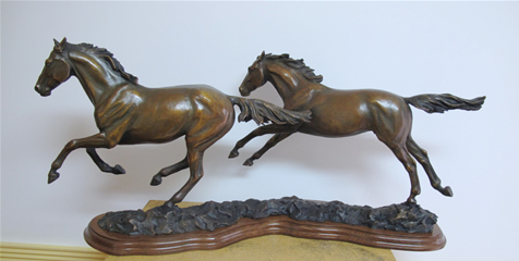 Bronze horse sculpture, Running Free, two horses galloping