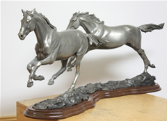 Running Free, bronze horses galloping