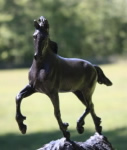 Horse sculpture of young friesian horse